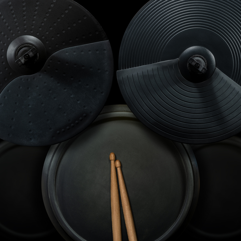 Black Electronic Drum Kit and Wooden Drumsticks