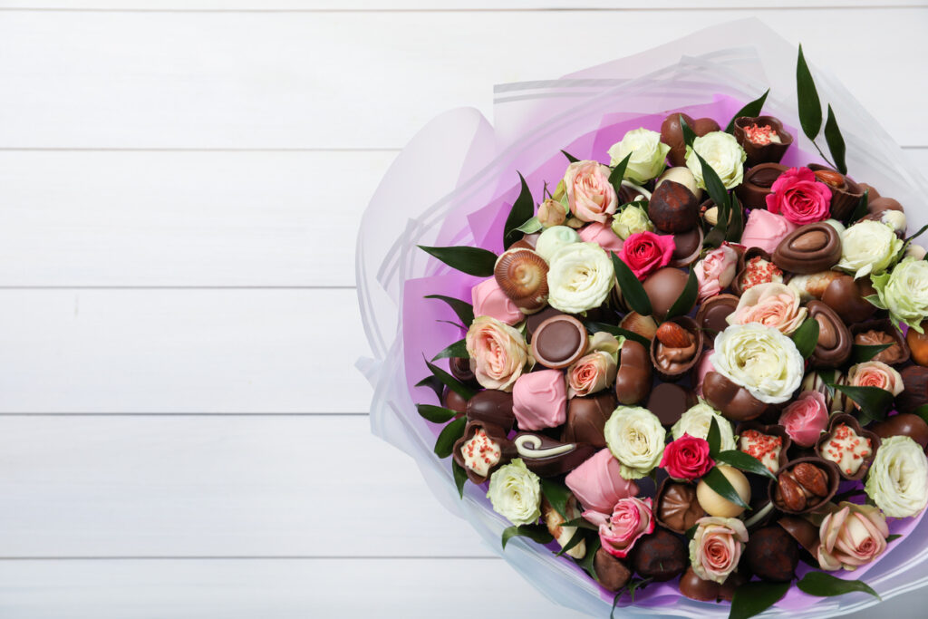 Beautiful bouquet of flowers and chocolate candies gift