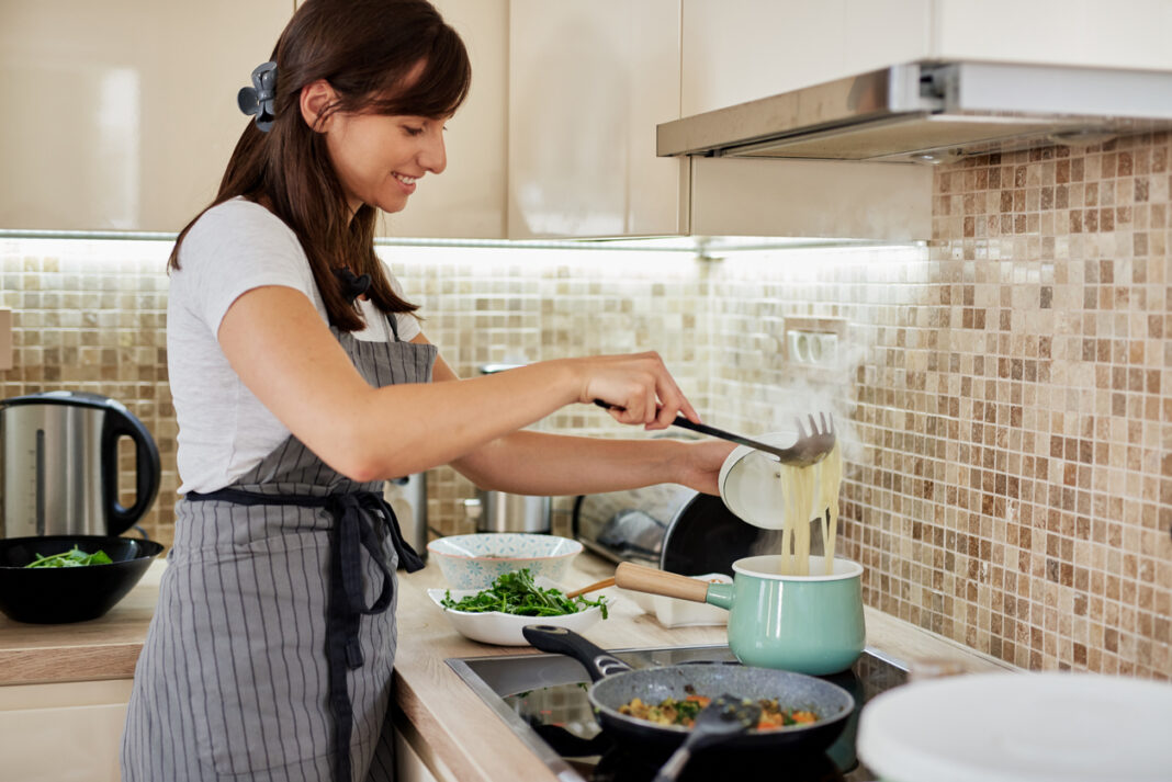 Woman preparing food for her guests