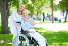 senior woman with her caregiver outside